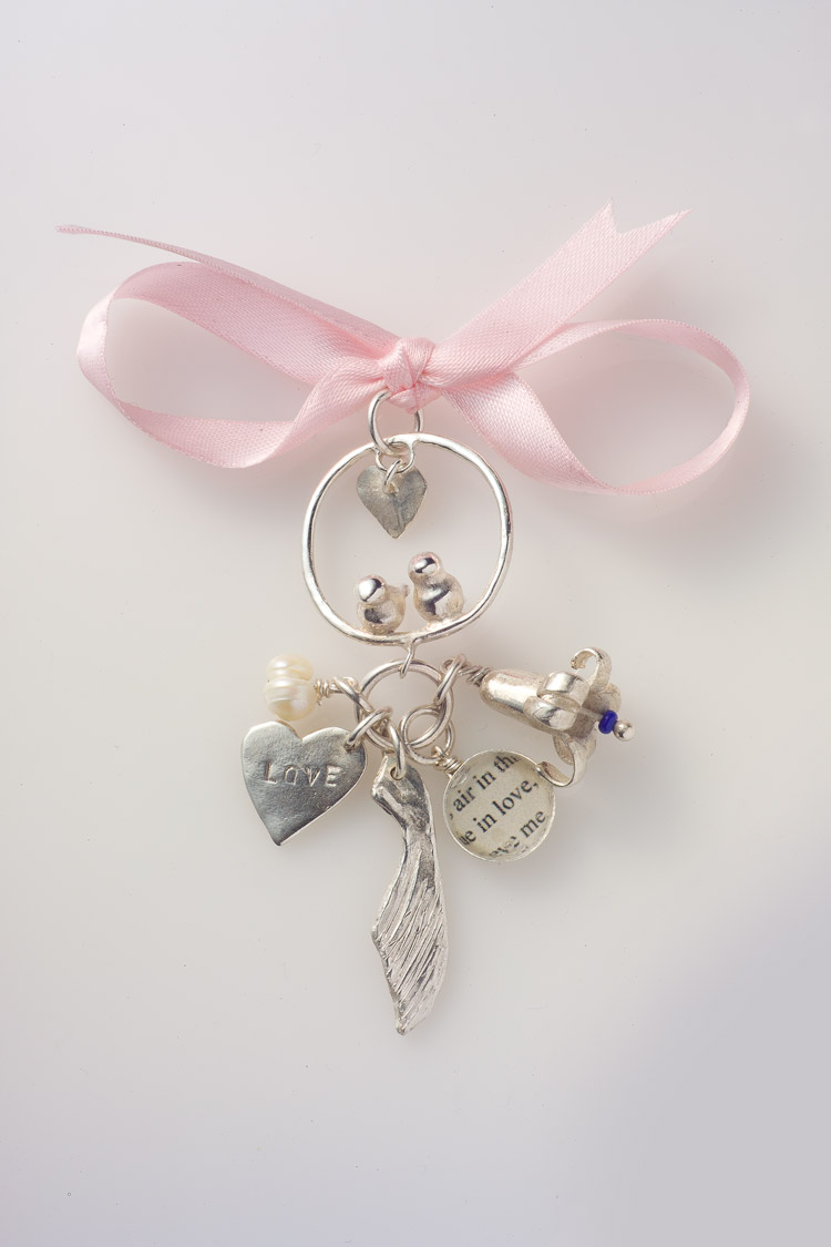 Charm cluster broach pendant on ribbon